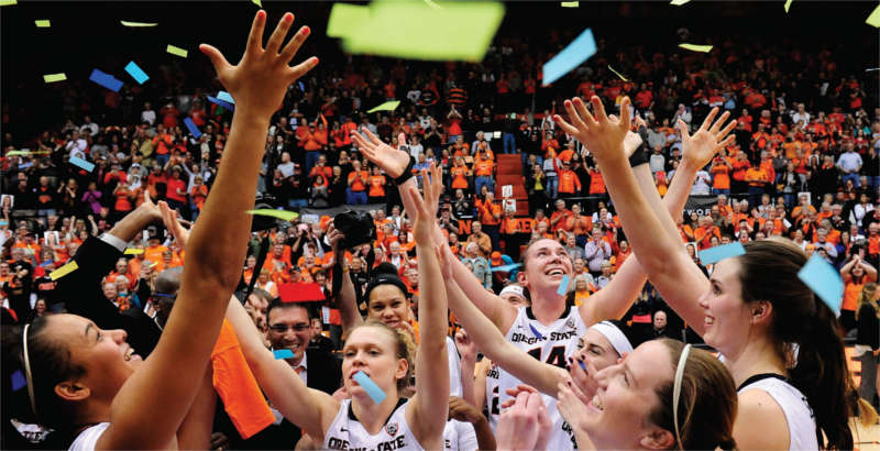 Oregon State Women's Basketball team celebrating a win
